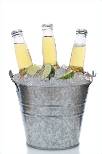 Picture Of Three Clear Beer Bottles In Ice Bucket