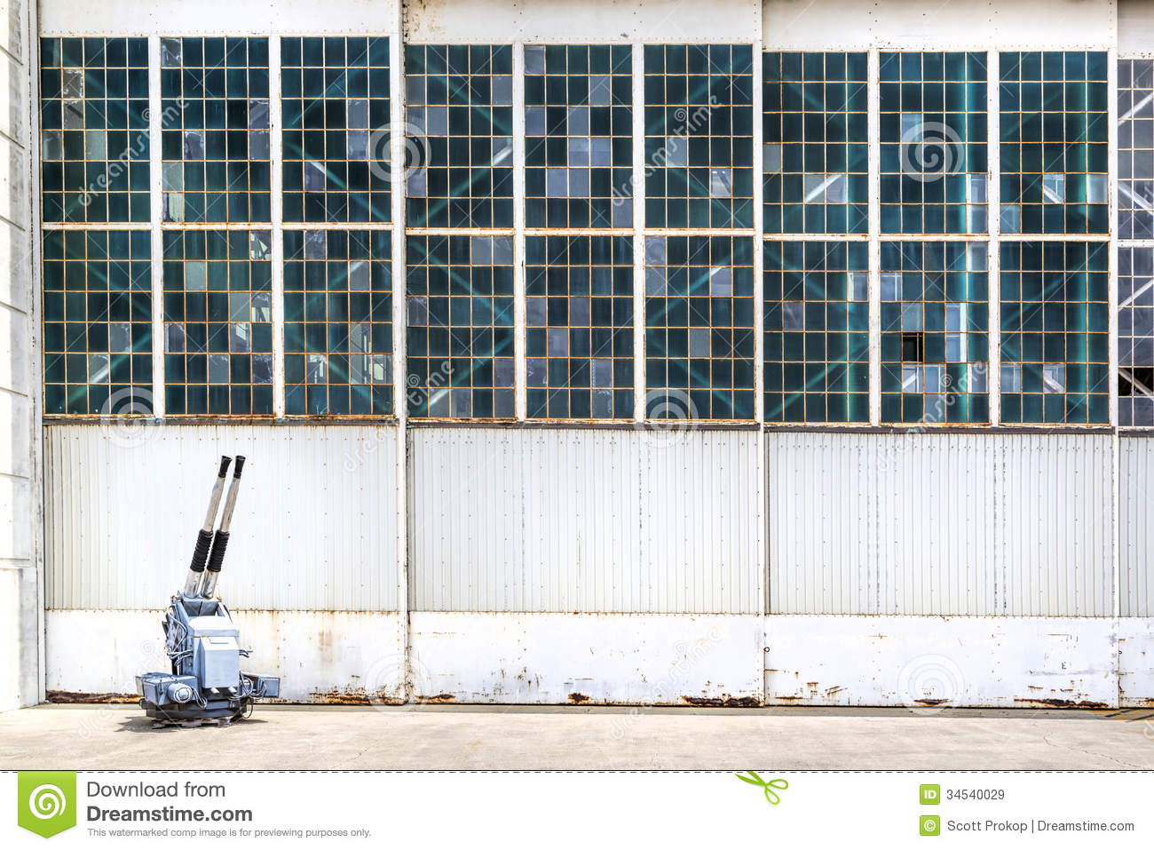 The Airport Hangar At With The Glass Damaged From A Gun Attack