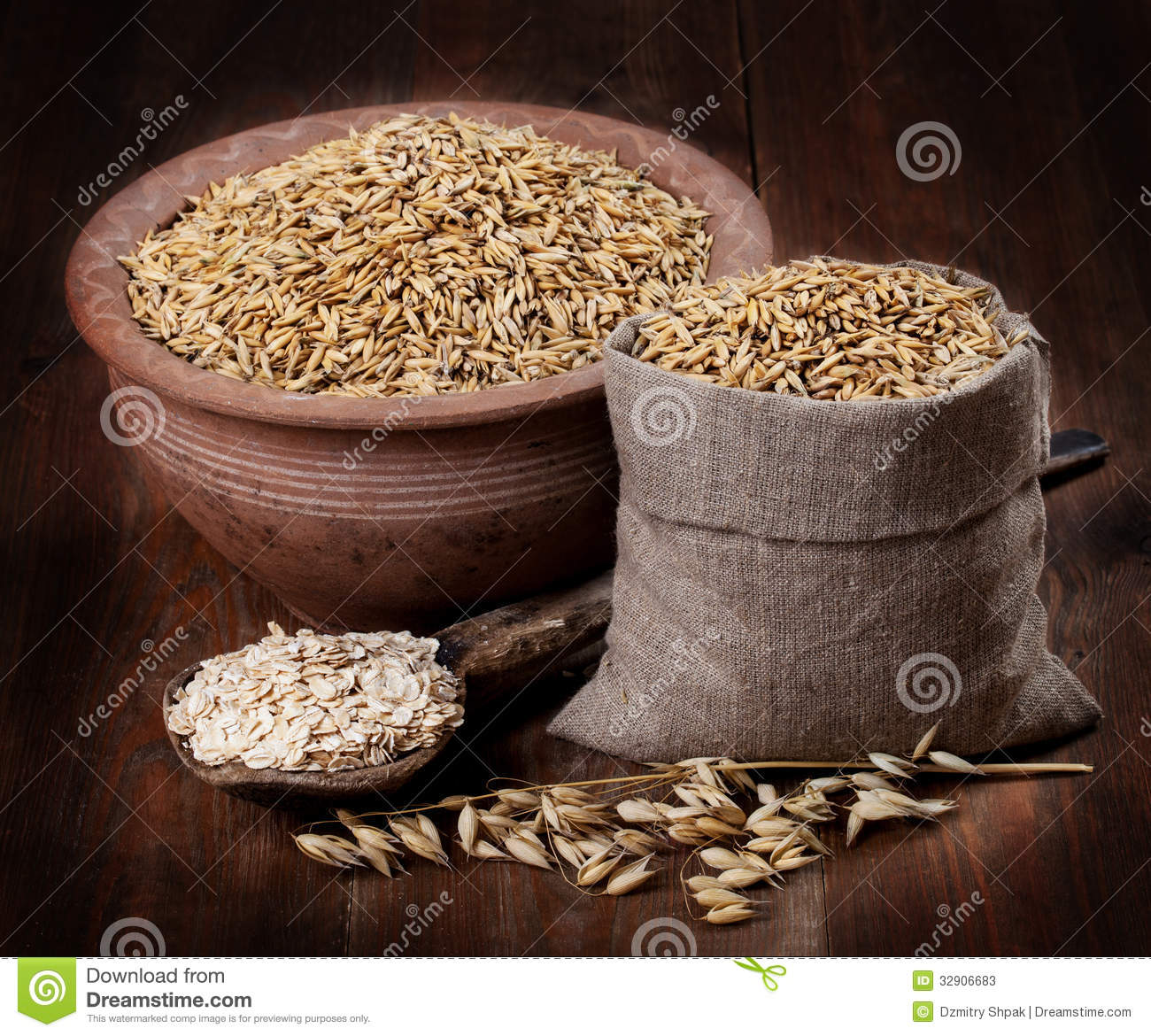 Oats And Oat Flakes On The Table In A Bag And An Old Bowl And Sp Stock