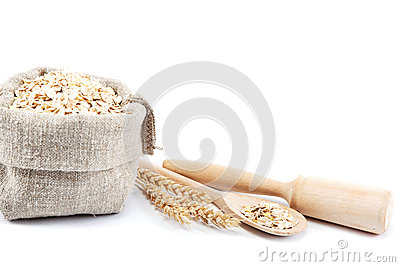 Rolled Oats In A Bag With A Wooden Spoon And Wheat Ears Isolated On
