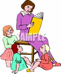 Kindergarten Teacher Reading A Story To Her Students   Royalty Free