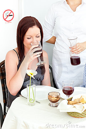 Happy Girlfriend Drinking Wine At The Restaurant Royalty Free Stock